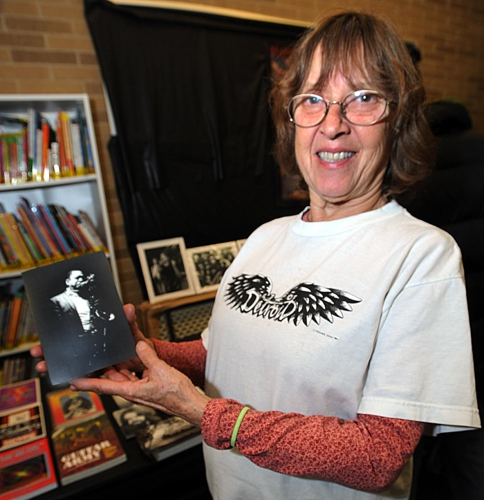 Photographer Leni Sinclair holds a photo she shot of her favorite musician John Col-trane during a Nov. 10 exhibit of her work at the Allen Park Public Library.