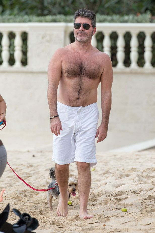 Simon-Cowell-seen-taking-Lauren-Silverman-and-little-Eric-on-sunset-boat-ride-on-his-first-Christmas-day-in-Barbados