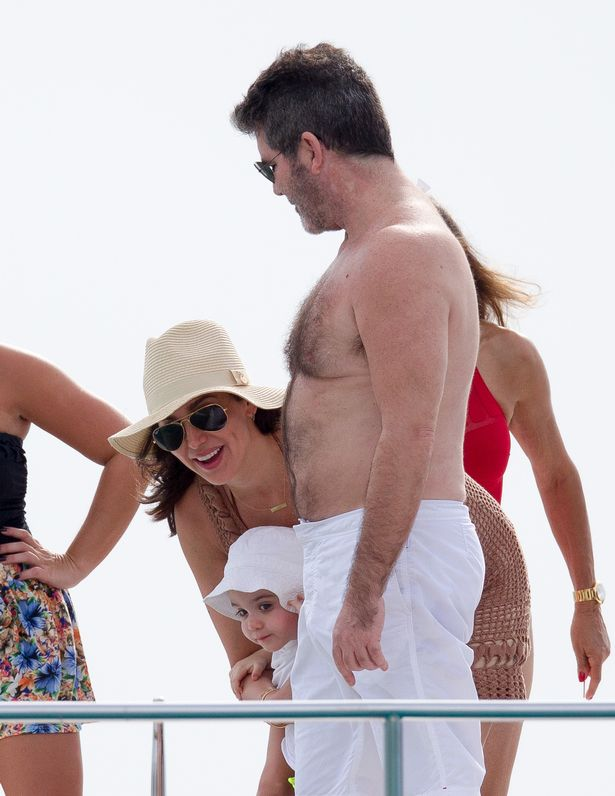 Simon-Cowell-seen-taking-Lauren-Silverman-and-little-Eric-on-sunset-boat-ride-on-his-first-Christmas-day-in-Barbadosghh