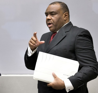 Jean-Pierre Bemba enters the court room of the International Criminal Court in The Hague, Netherlands, Monday, March 21, 2016. The International Criminal Court is passing judgment on former Congolese vice president Bemba on charges of commanding a militia that went on a spree of murder, rape and pillage in Central African Republic more than a decade ago. The verdicts being delivered Monday afternoon focus on the responsibility of a military commander for the actions of his troops. Bemba's long-running trial also was the first at the ICC to feature allegations of systematic sexual abuse by soldiers in a conflict.