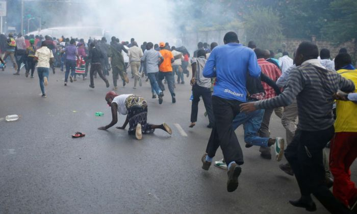protesters-run-from-riot-police-in-nairobi