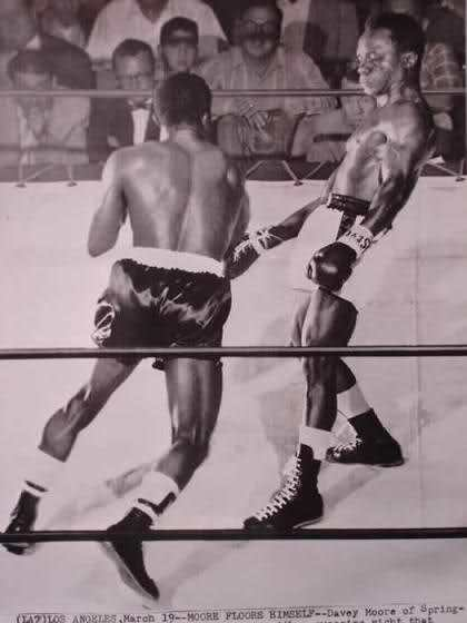 He defeated French Algerian Cherif Hamia in Paris on June 24, 1957 to claim the World Featherweight title
